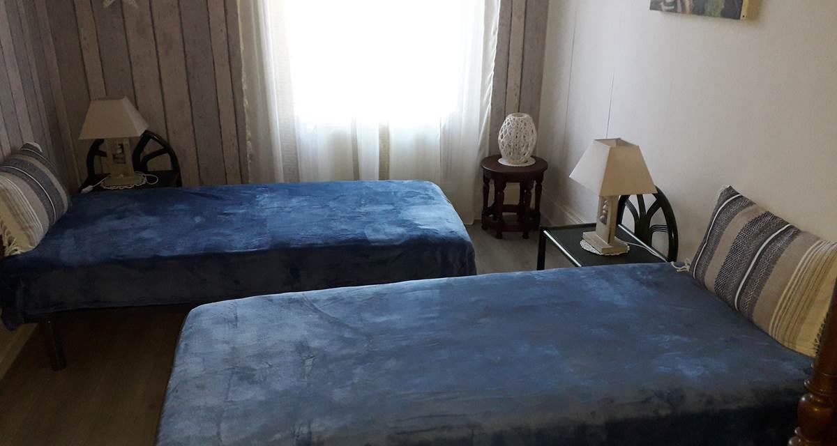 Chambre communicante à lits simples