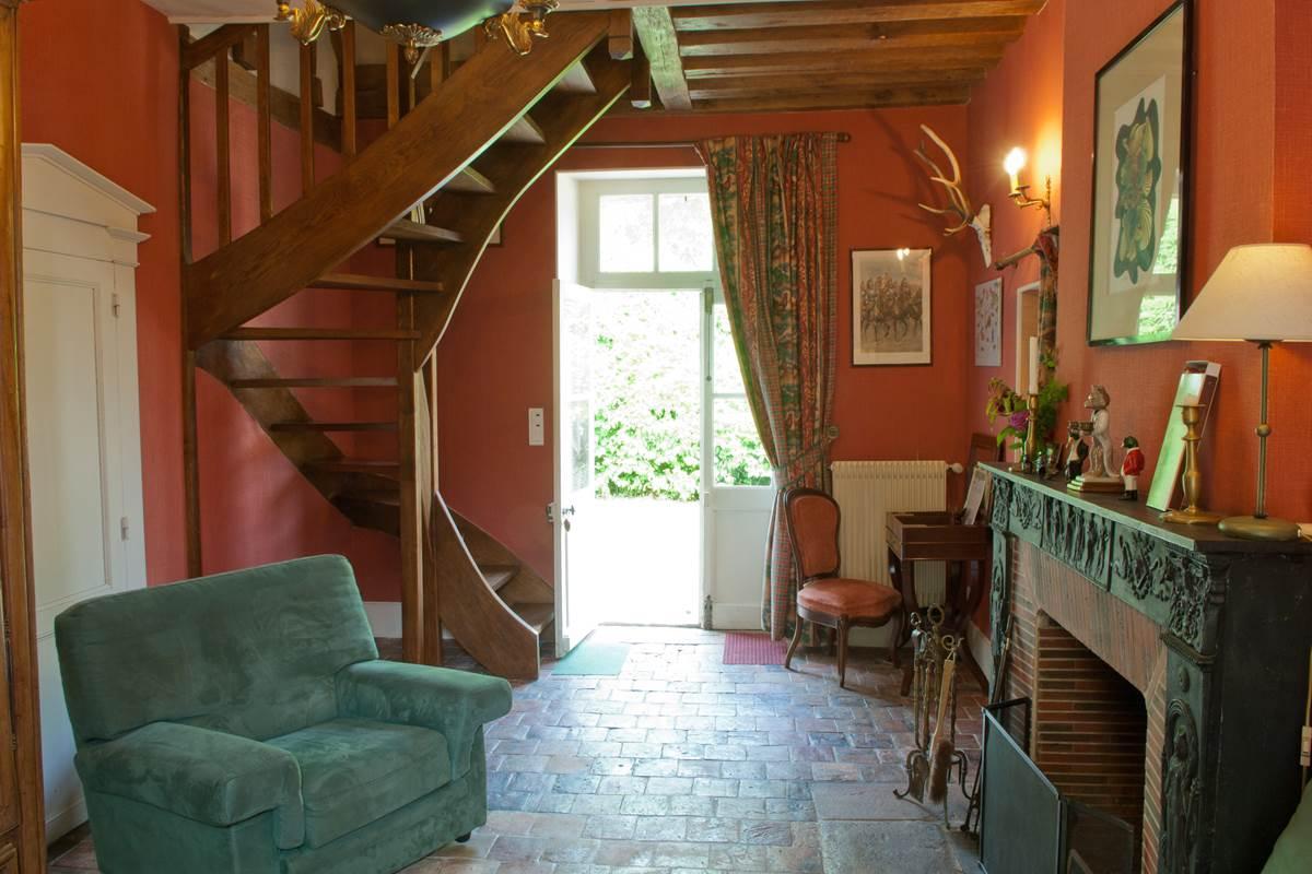 L'Annexe le salon de la suite familiale avec cheminée