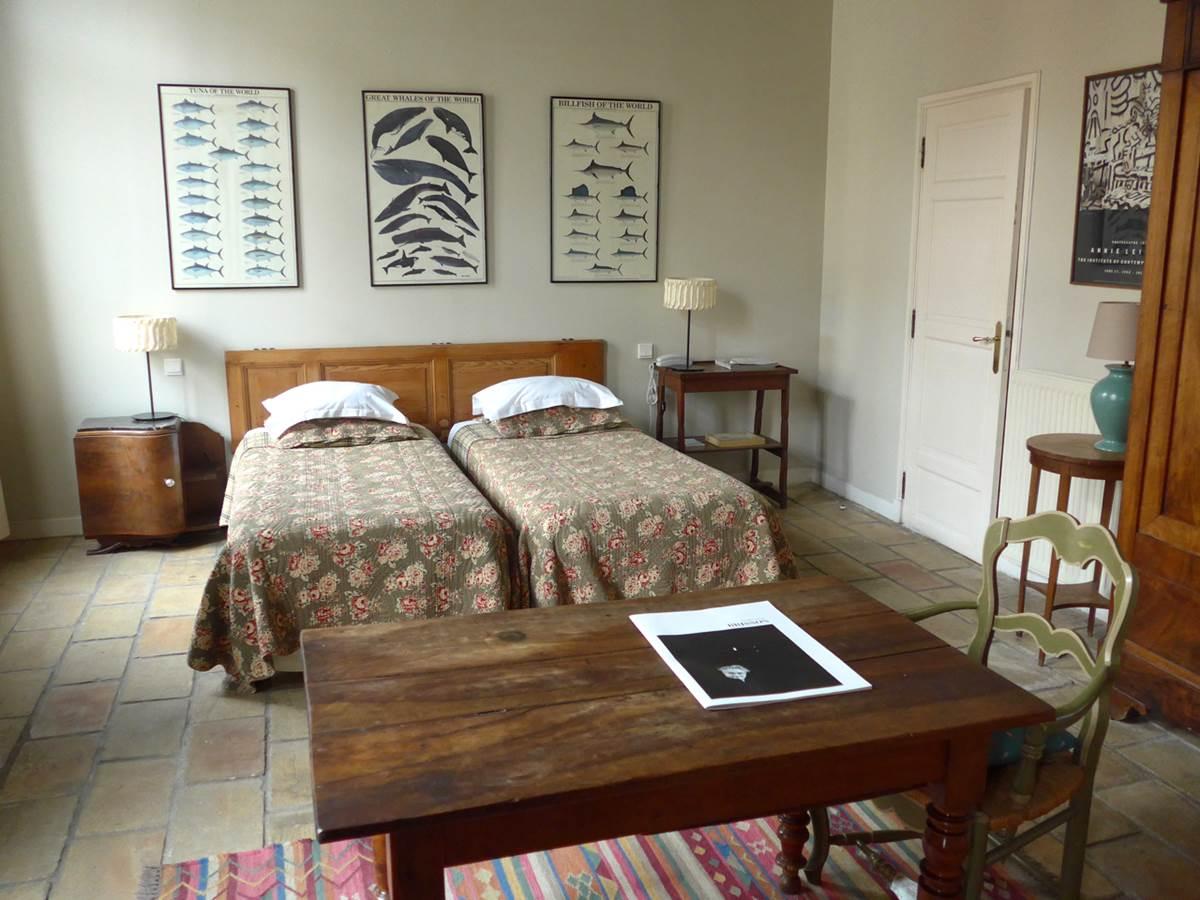 2 lits simple pour cette chambre de caractère