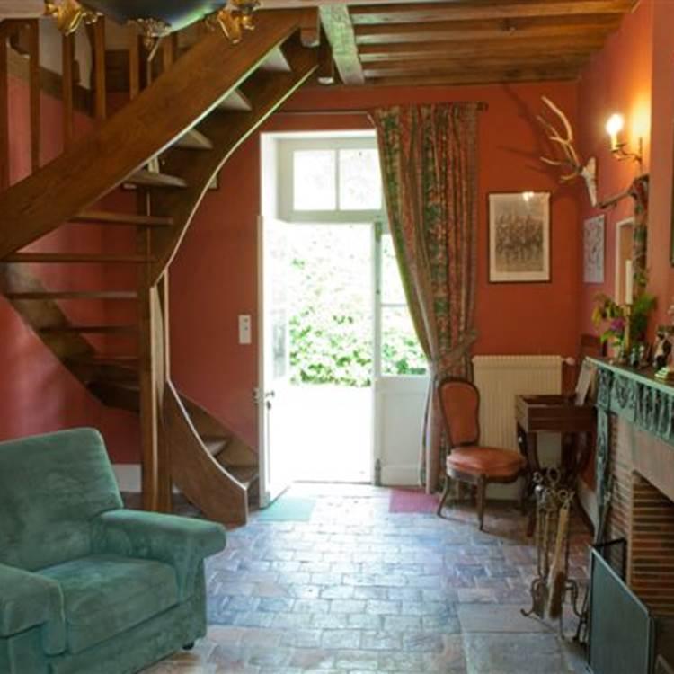 L'Annexe Le salon en rez de chaussée de la suite familiale