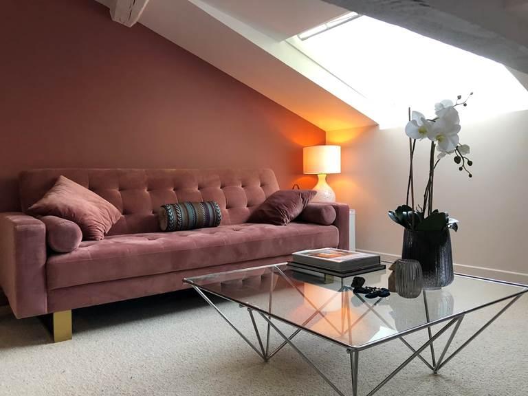 Suite Cypres et Acacias - Salon TV et canapé lit