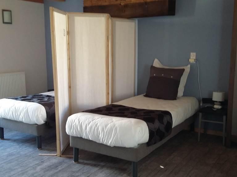 la chambre Alsace Lits simples avec paravent