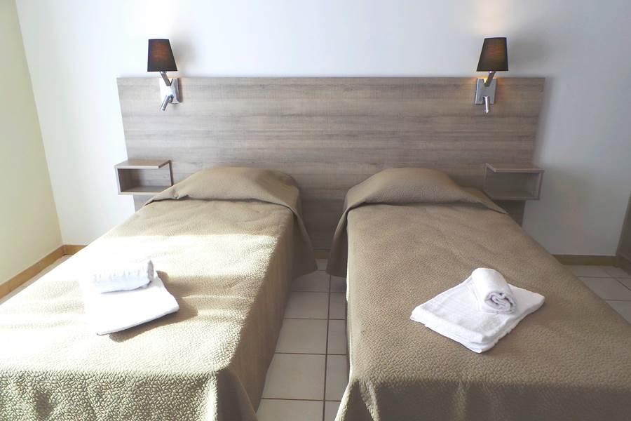 Chambre double lits séparés